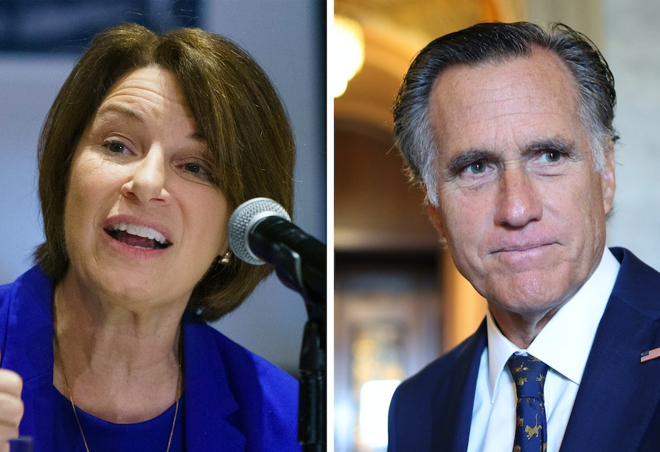 caption: Democrat Amy Klobuchar of Minnesota and Republican Mitt Romney of Utah are urging the Biden administration to step up work protecting Afghan journalists.
