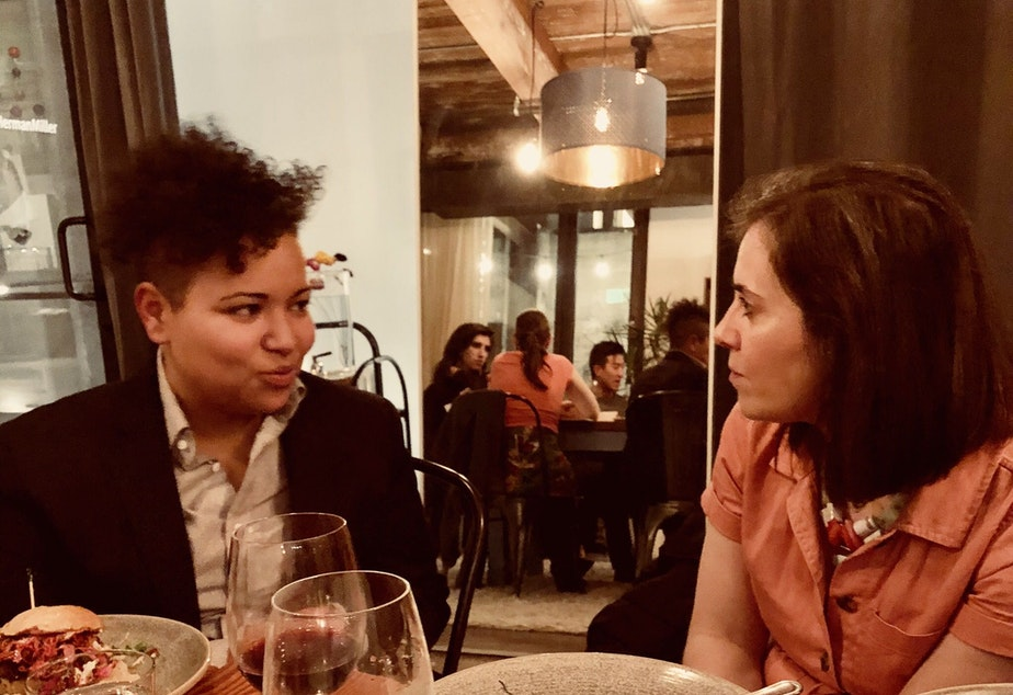caption: Curiosity Club member Mellina White Cusack (left) talks with KUOW journalist Isolde Raftery at The Cloud Room in Seattle during the inaugural KUOW Curiosity Club dinner on January 17, 2019. Raftery's story on a 14-year-old boy who died after refusing a blood transfusion that could have saved his life was part of the collection of KUOW stories that fueled conversation that night.