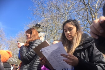 Rhiannon Rasaretnam scribbles notes for her speech for Seattle's March for Our Lives before she goes on stage.