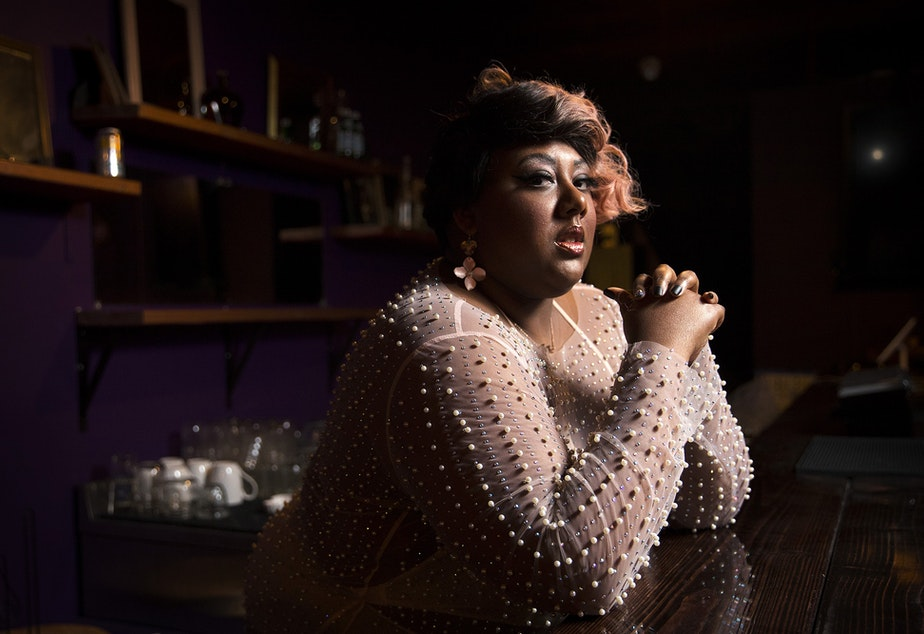 caption: Burlesque performer Mx. Pucks A' Plenty poses for a portrait on Friday, April 9, 2021, at the new Burlesque space along Northwest Market Street in Seattle.