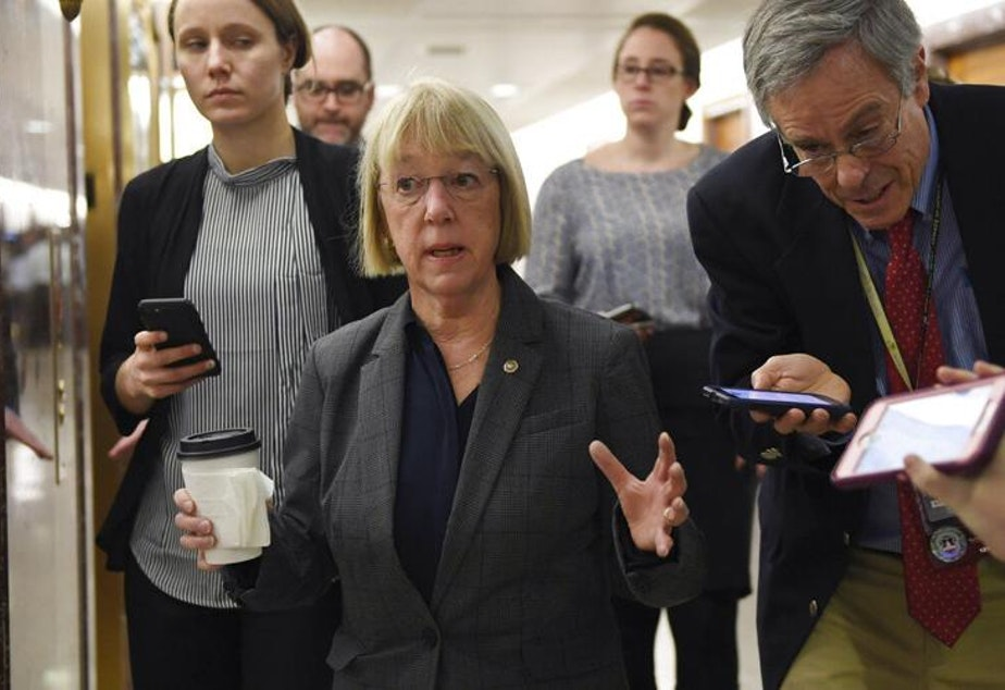 caption: Sen. Patty Murray, D-Wash., center, talks to reporters on Capitol Hill in Washington, Friday, Jan. 24, 2020, as she heads to a closed, all-senators briefing on the coronavirus.