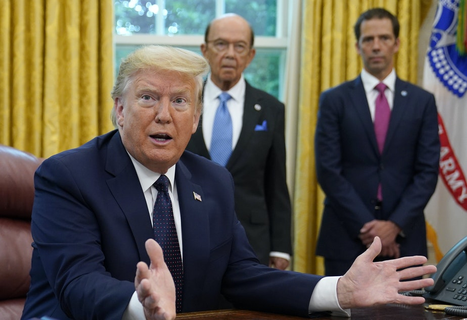 caption: President Trump speaks before signing an executive order aimed at curbing protections for social media companies in the Oval Office on Thursday.