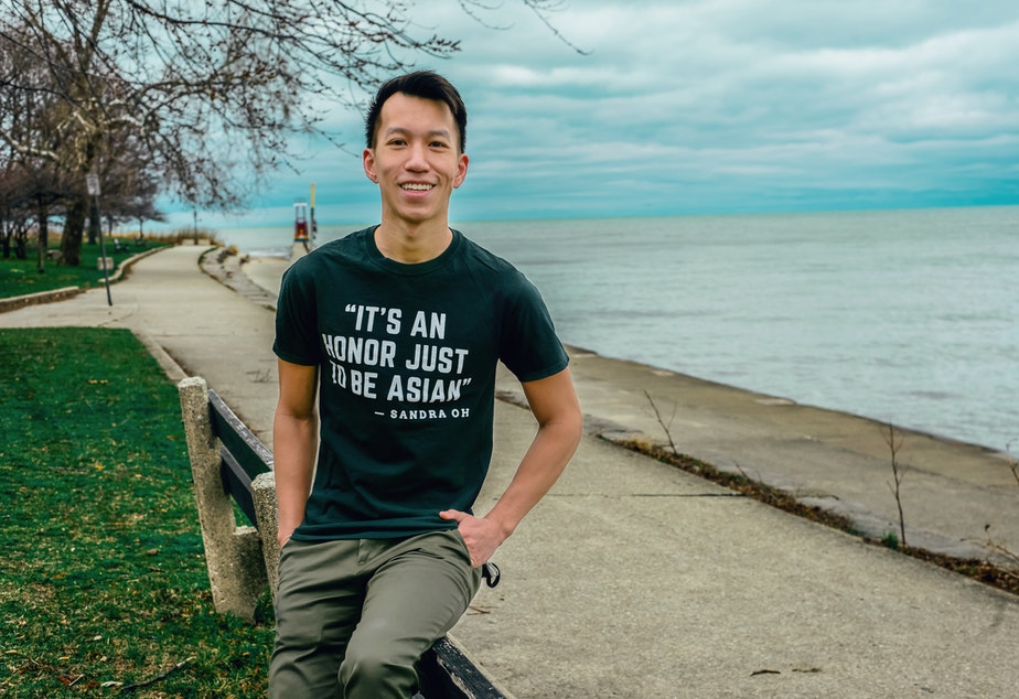 caption: Simon Tran sits for a portrait in Chicago, March 2021.