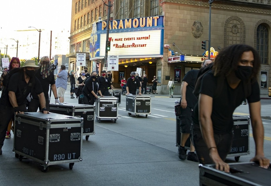 caption: Stagehands in front of the Paramount Theatre