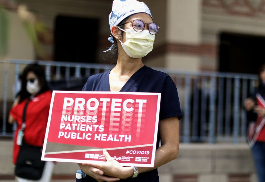 caption: Registered nurses and healthcare workers at UCLA Medical Center in Santa Monica, Calif., protested in April what they said was a lack of personal protective equipment for the pandemic's front line workers.