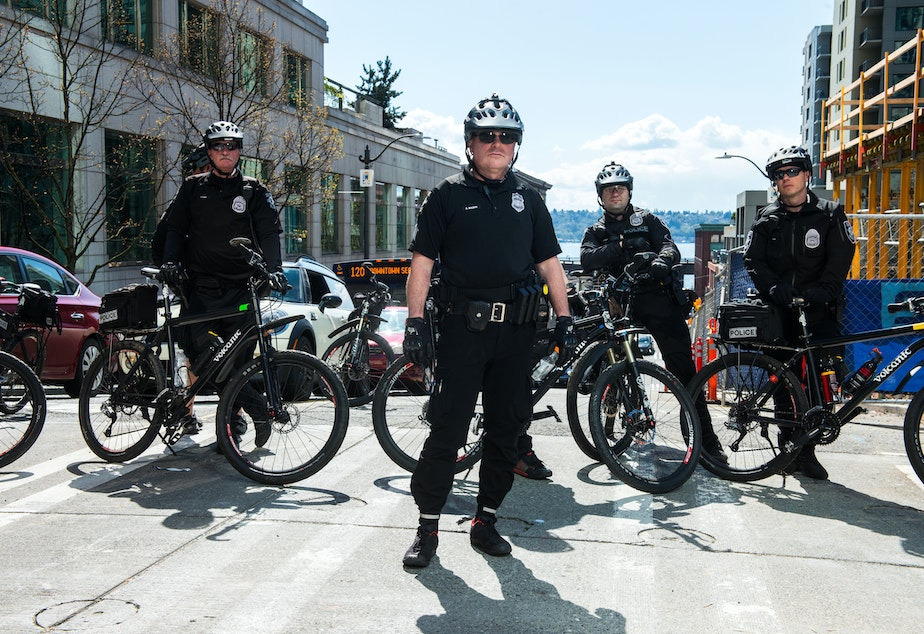 Seattle police officers observe marchers moving down 4th Avenue during the Black Lives Matter rally in Seattle.