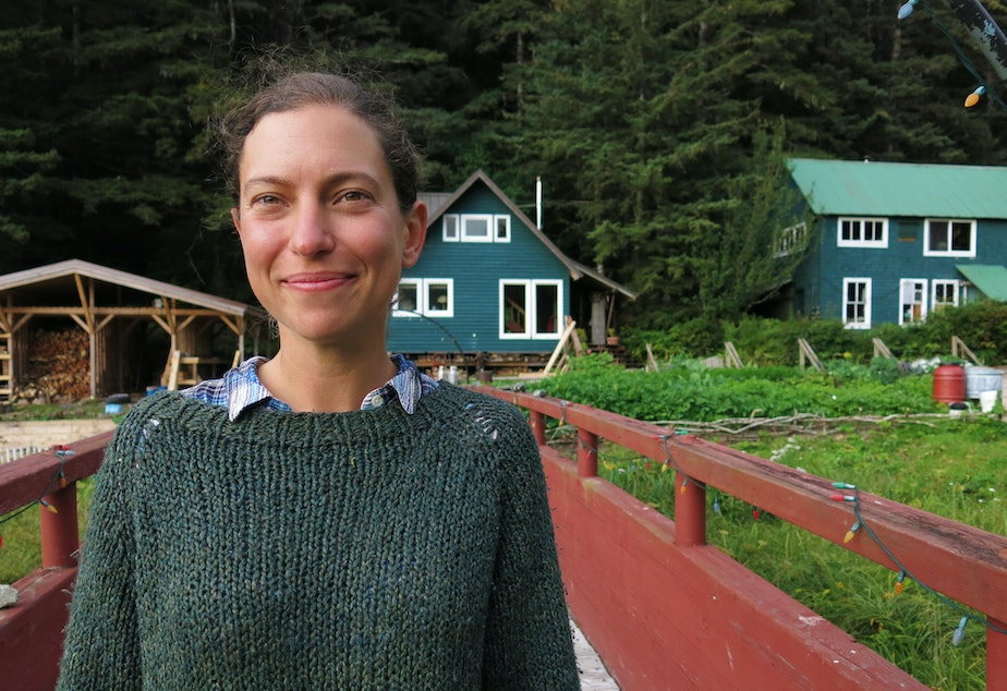 "Laura Marcus, founder of The Arete Project, stands in front of the campus, lovingly called the ""Hobbit Hole."""