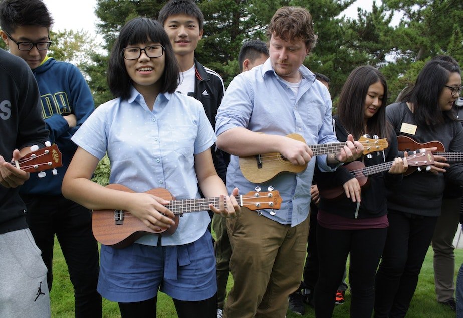 Mai Nguyen from Vietnam leads the Shoreline Community College Ukulele Club in a song.