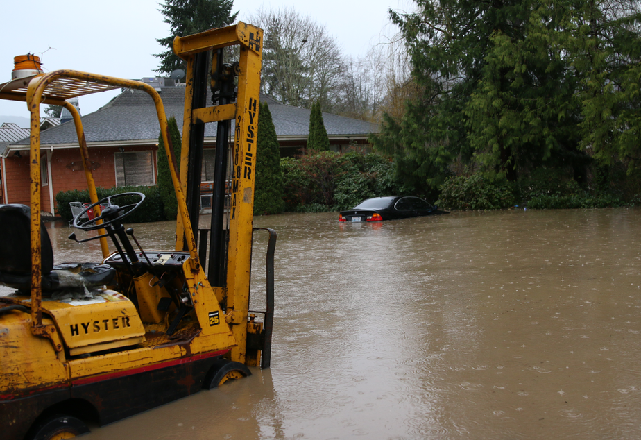 caption: Issaquah Creek floods on Feb. 6, 2020, near Gilman Boulevard.