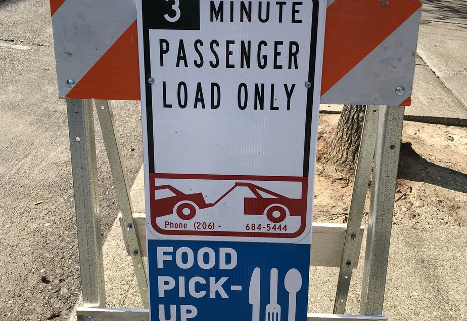 caption: A 3-minute passenger load only for food pick-up on Capitol Hill. Restaurants have closed during the coronavirus pandemic, with only take-out and deliver options available.