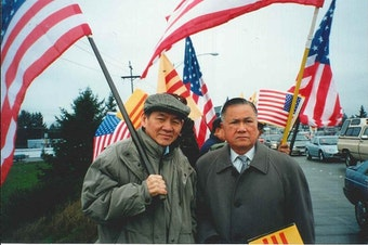 Thanh's father, Duc Tan, holds the American flag and stands next to Dr. Dung Nguyen, president of the Vietnamese Community of Pierce County, at a political rally in this undated photo.