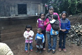 Sara Cano with five of her six kids in front of her home in San Antonio Las Nubes, Huehuetenango, Guatemala. Her husband, Oscar Leonel Lopez, tried to immigrate to the U.S. but was deported back home.