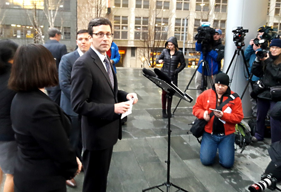 caption: Washington Attorney General Bob Ferguson prepares to talk to the media about a federal judge's ruling on the Trump refugee order Friday, Feb. 3, 2017.