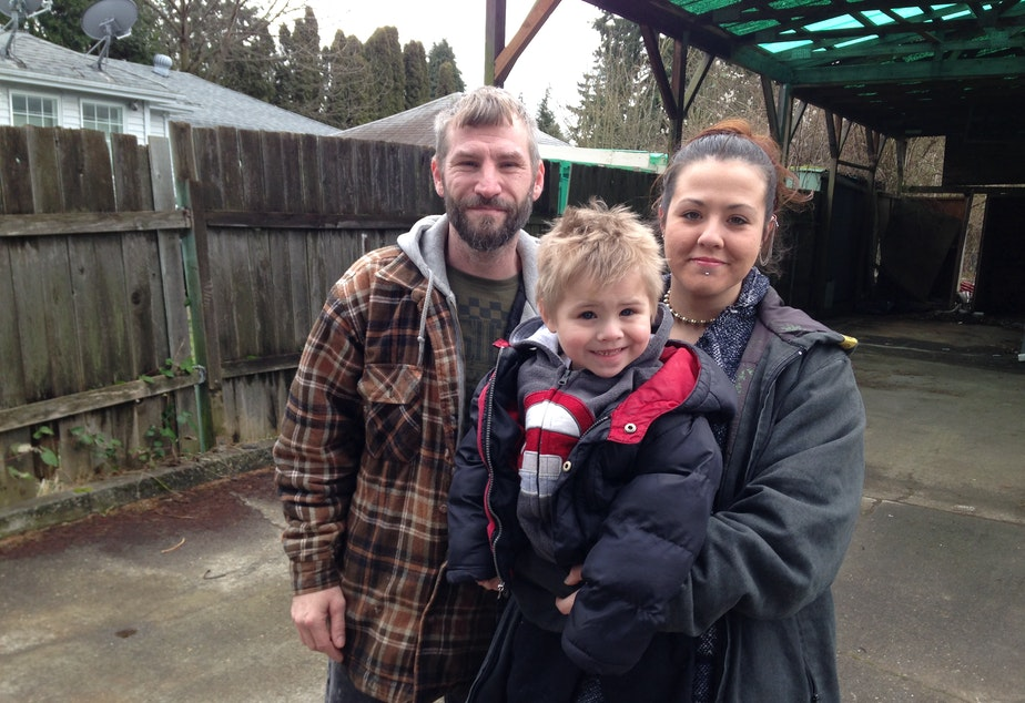 Larry Jametsky, Christina Stewart and their son Lawrence outside the home they say they lost in a fraudulent loan deal.
