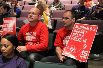 Community members attend a public hearing about raising the minimum wage in Seattle.