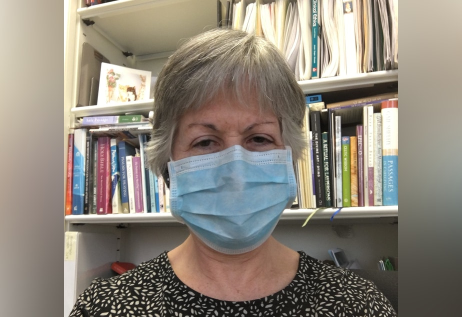 caption: 'I am smiling in this photo. Can you tell?' Deborah Thompson at Swedish Medical Center said safety precautions make it hard to comfort and communicate with patients right now.