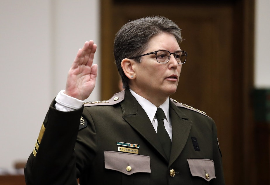 caption: A file photo King County Sheriff Mitzi Johanknecht being sworn in on Jan. 2, 2018, in Seattle. Johanknecht was elected to the position. A ballot measure asks voters to decide whether the position should be appointed.