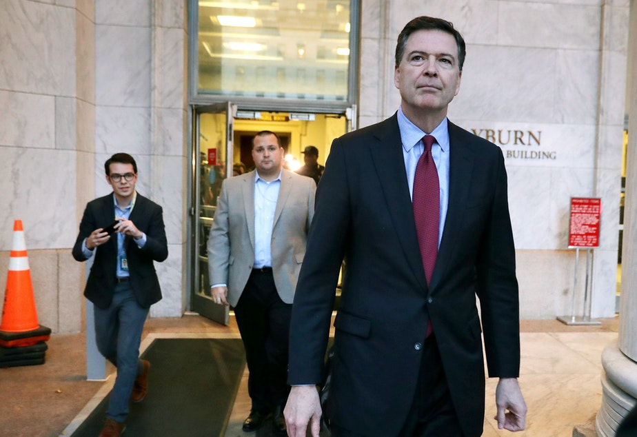 caption: Former FBI Director James Comey leaves the Rayburn House Office Building after testifying to the House judiciary and oversight committees on Capitol Hill on Dec. 7, 2018.