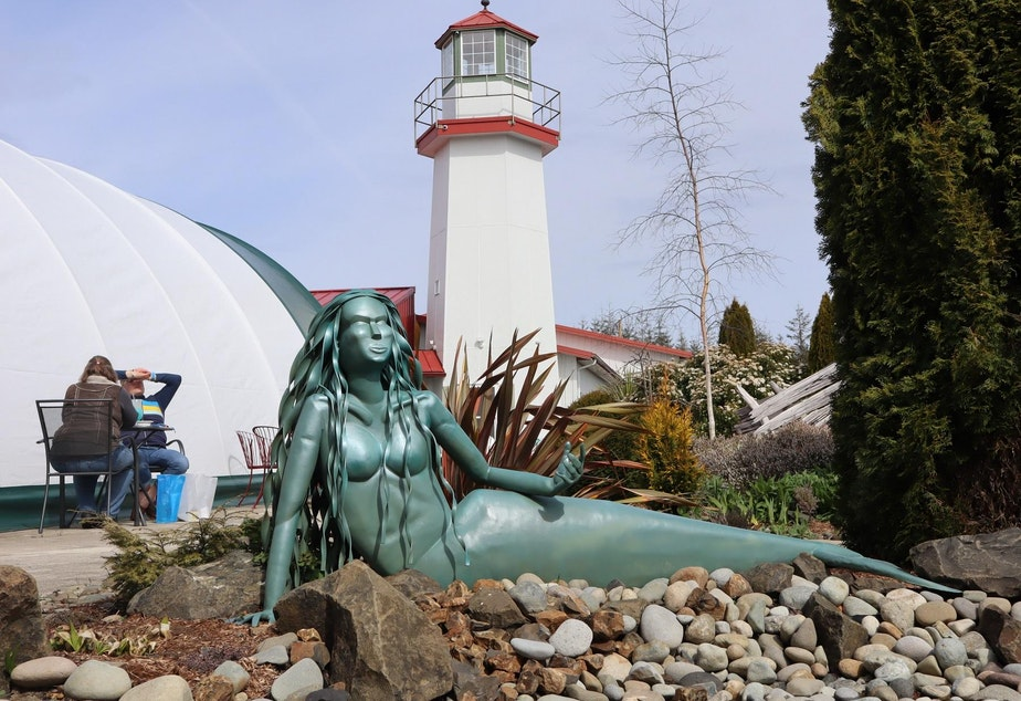 caption: Mermaid sculptures adorn the grounds of the mermaid museum and adjacent Westport Winery.