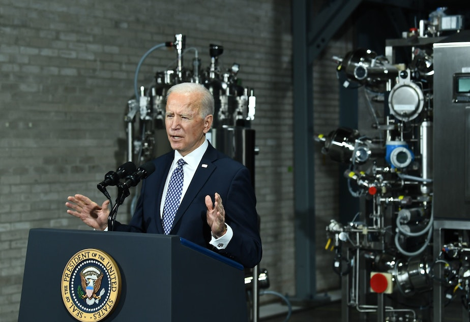 caption: President Biden speaks Friday at a Pfizer COVID-19 vaccine manufacturing site in Portage, Mich. The House could pass a version of his $1.9 trillion COVID-19 relief legislation this week.