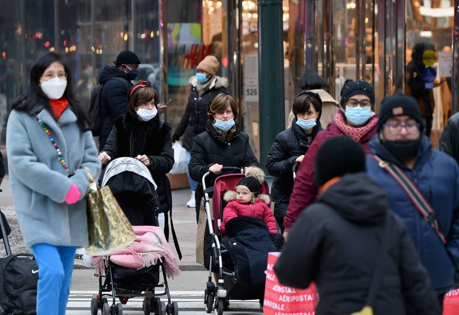 caption: People walk through a busy shopping area amid the coronavirus pandemic on Jan. 5 in New York City. Coronavirus cases are up in almost every state.