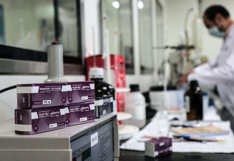 caption: Boxes containing vials of remdesivir at a pharmaceutical company in Giza, Egypt.