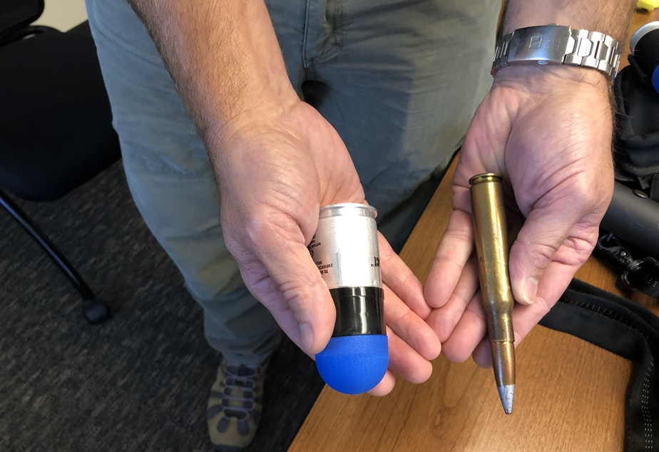 caption: On the right, the type of .50 caliber military round banned by HB 1054. On the left, the 40mm sponge-tipped less-lethal round also covered by the ban.
