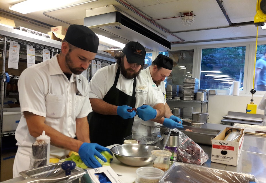 caption: FareStart, a Seattle non-profit that helps people transition from homelessness and addiction, had to retool its culinary training program during the pandemic.  In-person instruction, like this one, is now taught online.