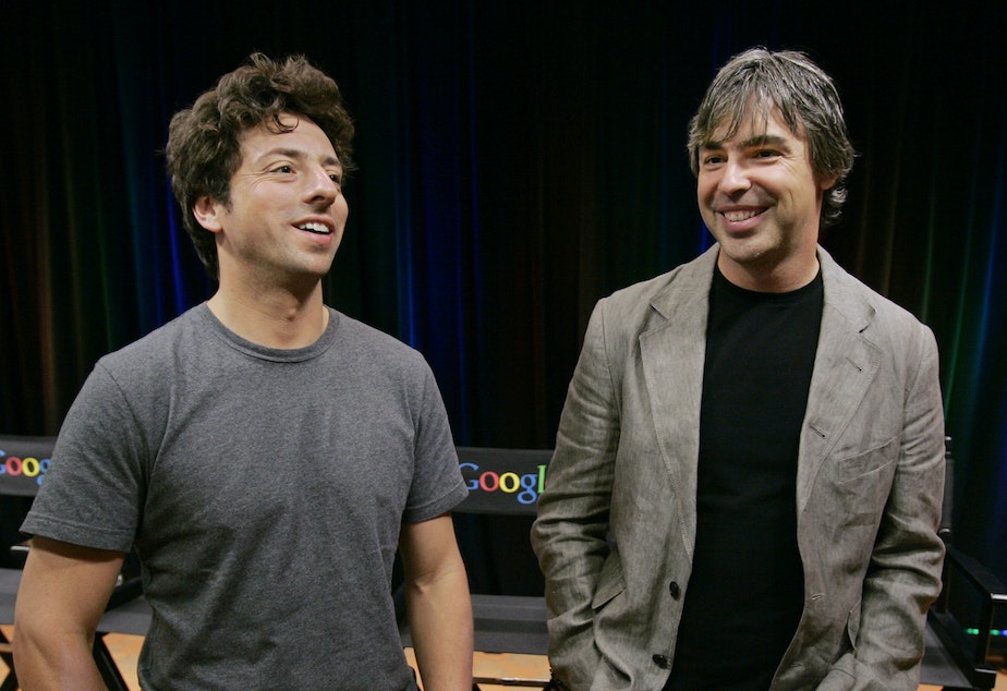 caption: Google co-founders Sergey Brin (left) and Larry Page announced Tuesday they are stepping down from their leadership roles but will remain board members of Alphabet, Google's parent company.