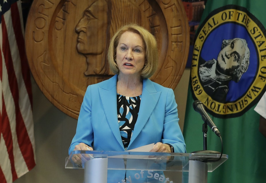 caption: Seattle Mayor Jenny Durkan speaks at a news conference during the summer of 2020. Durkan and the governor of Washington state told reporters that U.S. officers sent to protect federal buildings in the city have left.