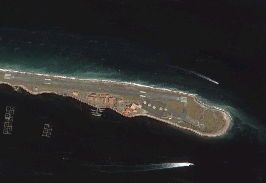 caption: Port Angeles' Ediz Hook, with Cooke's rectangular net-pen structures, housing about 700,000 Atlantic salmon, at lower left.