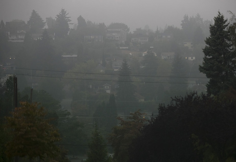 caption: Homes in Magnolia are shrouded in smoke from wildfires in Oregon and California on Saturday morning, September 12, 2020, in Seattle.