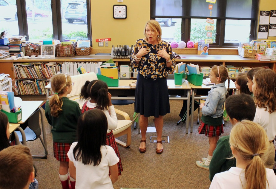 Dr. Tammy Fisher, counselor at St. Thomas School in Medina, leads a second grade class in an exercise meant to teach them social-emotional skills.
