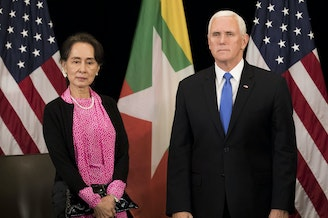 Vice President Mike Pence and Myanmar State Counsellor Aung San Suu Kyi arrive for a bilateral meeting on the sidelines of the Association of Southeast Asian Nations (ASEAN) summit in Singapore on Wednesday.