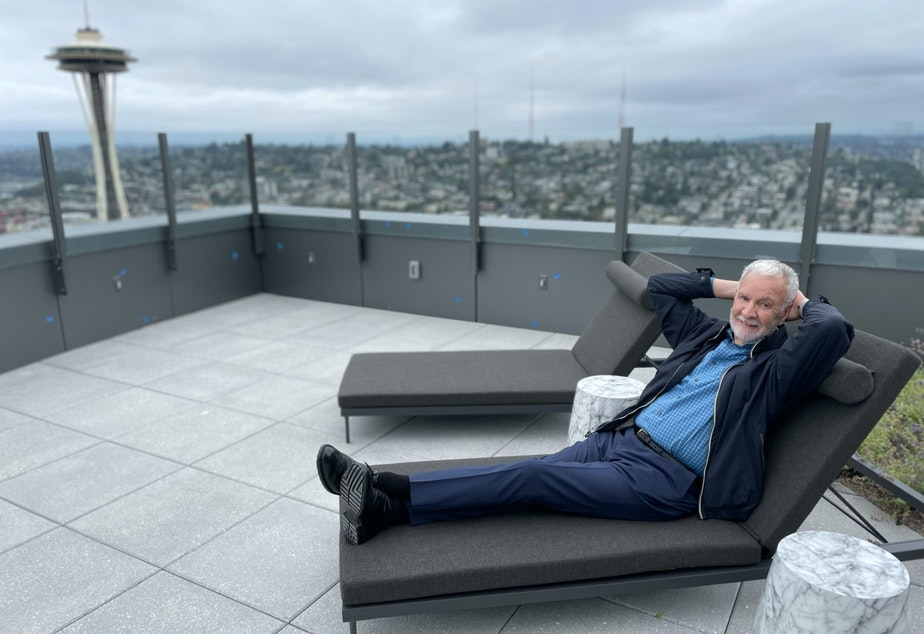 caption: Paul Menzies strikes a pose for a portrait on the roof deck of the Spire.