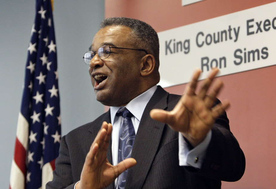caption: FILE: Ron Sims speaks at a news conference where he announced that President Barack Obama will nominate him to be deputy secretary of the U.S. Department of Housing and Urban Development, Monday, Feb. 2, 2009, in Seattle.