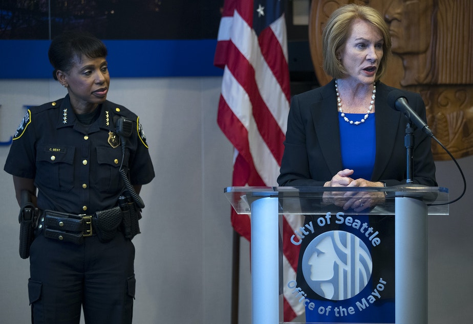 FILE: Seattle Mayor Jenny Durkan stands with Carmen Best as she answers questions from the press on Tuesday, July 17, 2018, at City Hall in Seattle.
