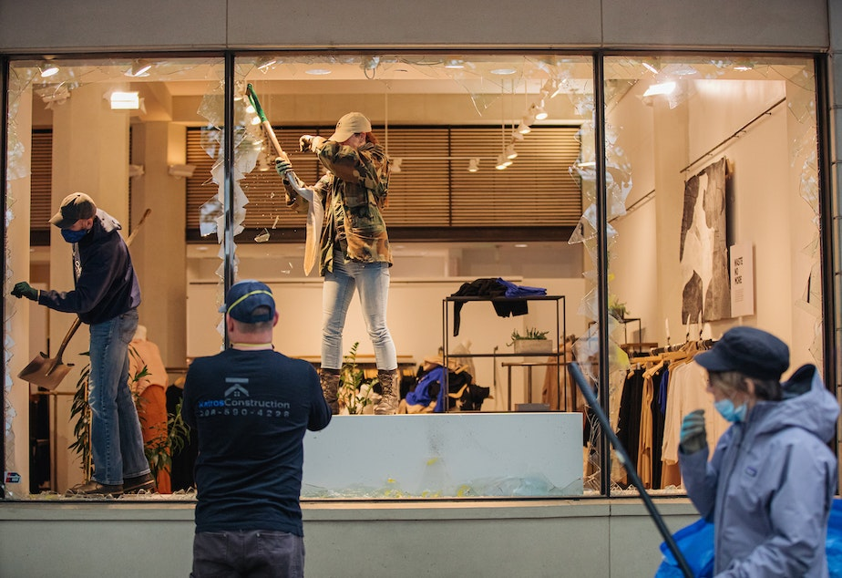 caption: The outside of a downtown Seattle retail store after a night of protests on Saturday, May 30. The protests were in opposition of police violence, and specifically the death of George Floyd at the hands of police.