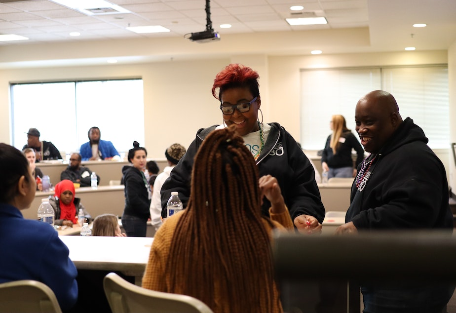 caption: Lady Jay Hunter (left) and Allen Hunter speak with participants at a Choose 180 Youth Diversion Workshop.