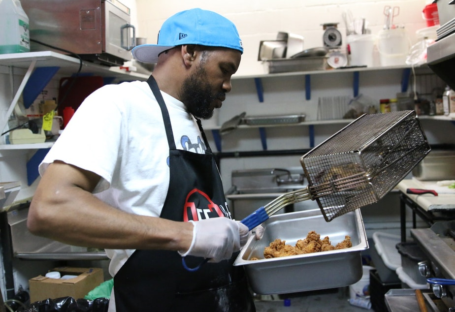 caption: Jimaine Miller prepares chicken tenderloin for po'boy sandwiches in the kitchen of Soulful Dishes on Yesler Way in Seattle. On the day KUOW visited, he was cooking for protesters in a south Seattle march, protesters at the CHOP, and a last minute paid event at the City of Seattle.