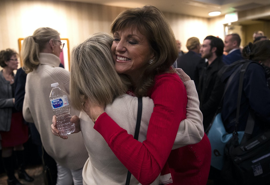 Susan Hutchison, right, hugs Polly Pearson on Tuesday, November 6, 2018, at the Hilton Garden Inn in Issaquah.