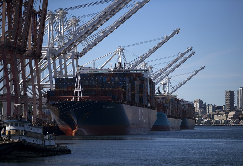 caption: The ZIM San Diego, far right, is shown on Thursday, June 17, 2021, at the Port of Seattle.