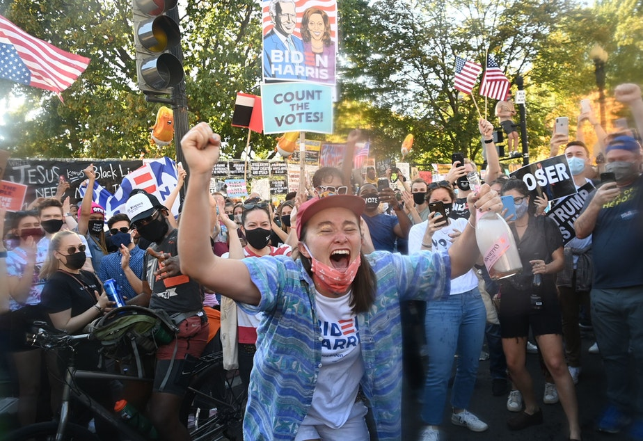 caption: Soon after Joe Biden was declared the winner of the 2020 presidential election Saturday, a celebratory crowd headed to Black Lives Matter Plaza across from the White House in Washington, D.C.