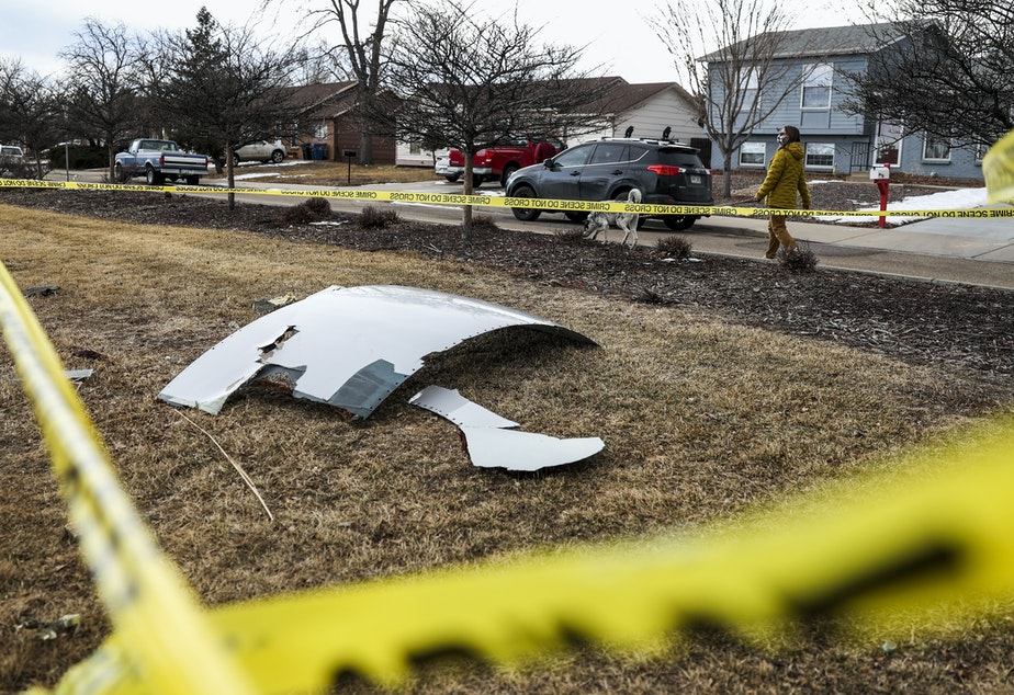 caption: Pieces of the airplane engine from United Airlines Flight 328 sit scattered in a neighborhood after the jet's engine failure on Feb, 20 in Colorado. An engine on the Boeing 777 exploded after takeoff from Denver.