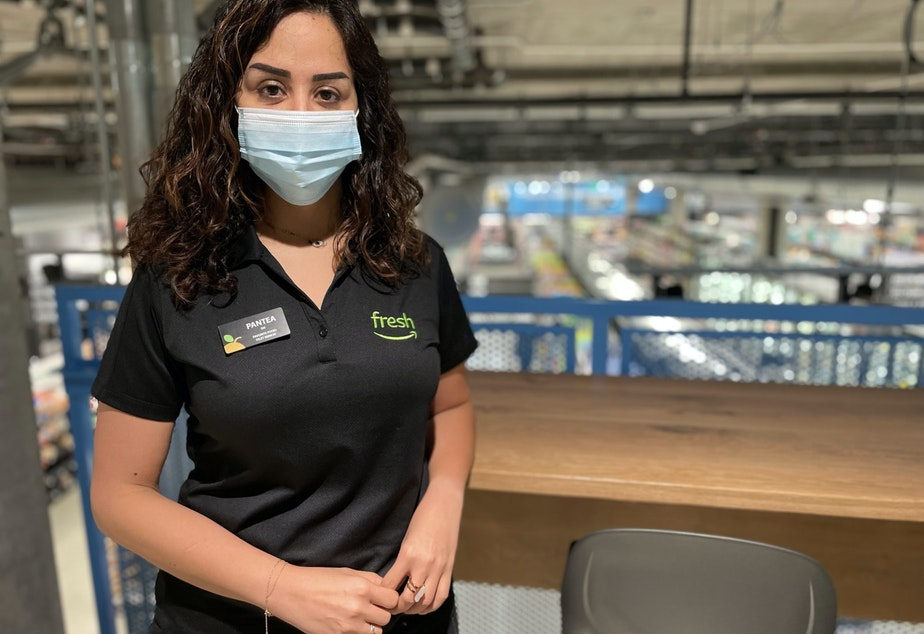 caption: Pantea Naghibi is the store manager at Amazon Fresh's 23rd and Jackson store