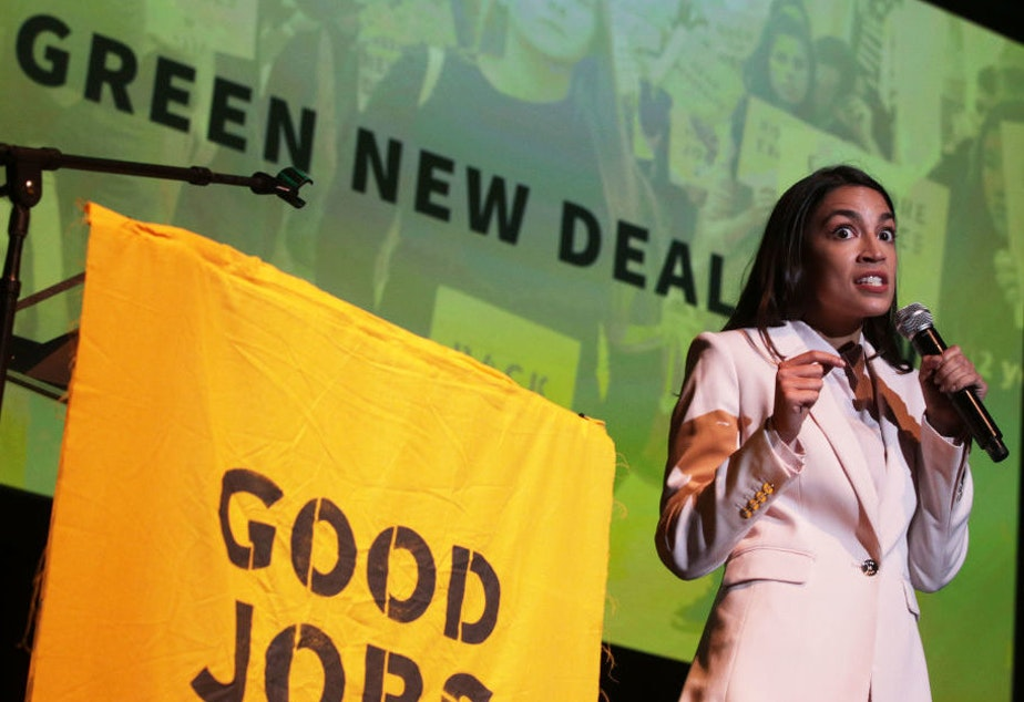 "caption: Rep. Alexandria Ocasio-Cortez, D-N.Y., speaks during a rally at Howard University on Monday. The Sunrise Movement held an event for the final stop of the ""Road to a Green New Deal"" tour to ""explore what the pain of the climate crisis looks like in D.C. and for the country and what the promise of the Green New Deal means."""