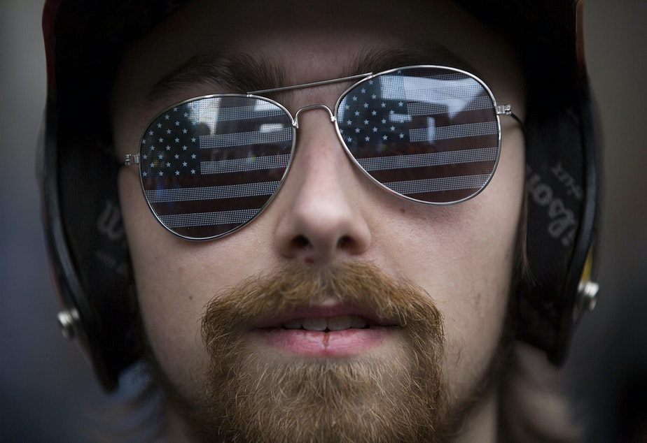 caption: Josh Potter of Vancouver, Wash. attends a pro-Trump rally at Westlake Plaza in downtown Seattle on Monday, May 1, 2017.