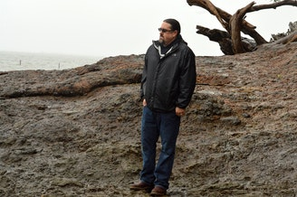 Tony Johnson of the Chinook Tribe is fluent in Chinook Wawa. He stands at Chinook Point near the mouth of the Columbia, a key spot for the fur trade 200 years ago where strangers met and needed a common language.