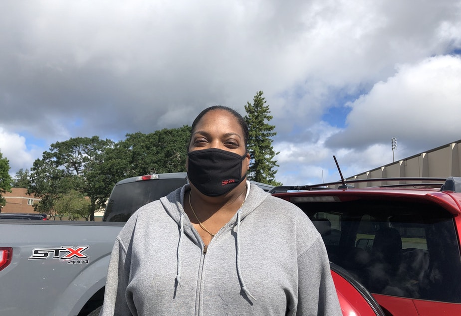 caption: Military veteran January Adams relies on her disability check to pay for rent, utilities, and other bills. Sometimes there's not enough left for food. Adams came to a recent food distribution event specifically for military families.