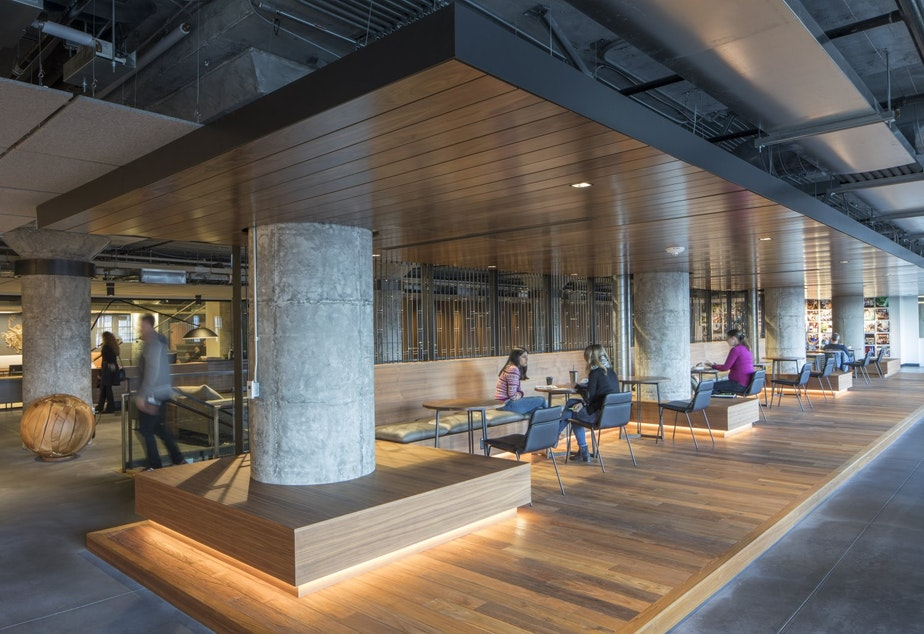 caption: Starbucks will trade some dedicated desks for collaborative workspaces that look more like a coffee shop during its year-long redesign of its SODO headquarters